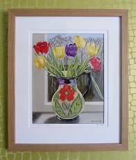 Tulips in a painted jug